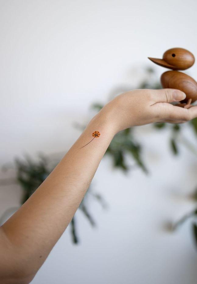 Micro Sunflower Tattoo