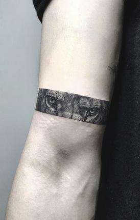 Lion Eyes Tattoo