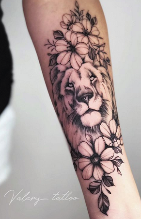 Lion in Flowers Tattoo