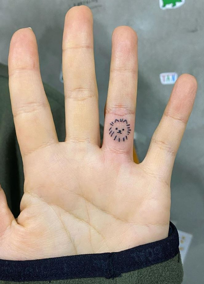Tiny Cat Face Tattoo