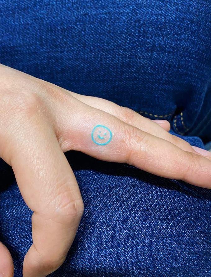 Tiny Smiley Tattoo