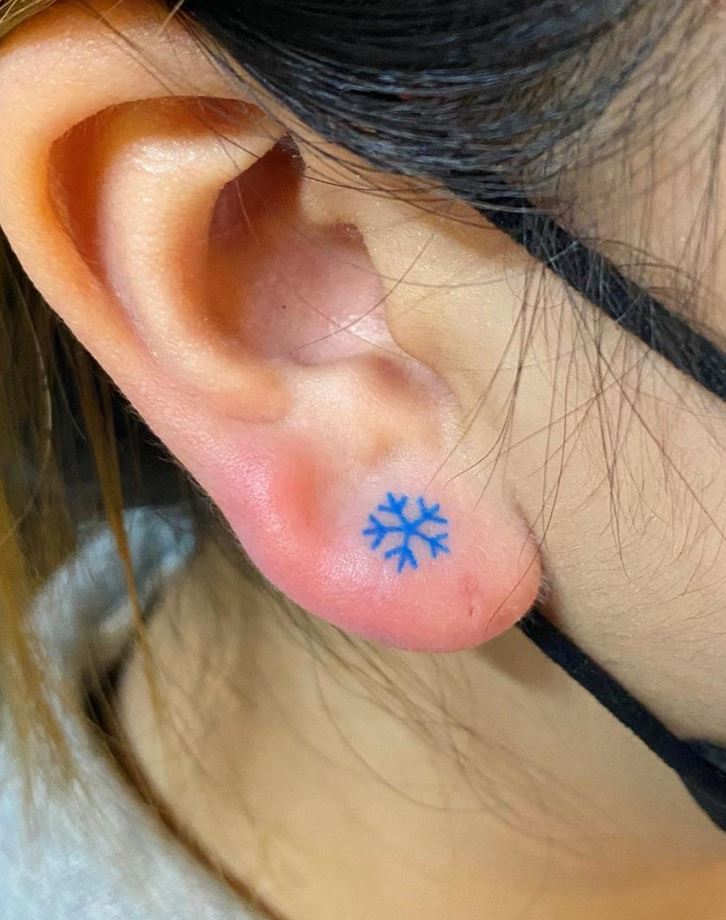 Tiny Snowflake Tattoo